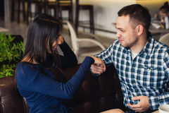 Man kissing his girlfriend`s hand before dinner.  stock photography