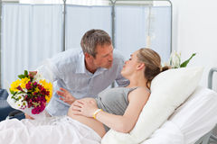 Man kissing his pregnant wife Stock Photos