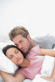 Man kissing his sleeping wife Royalty Free Stock Photography
