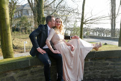 Man kissing his wife stock images