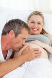 Man kissing his wife's belly Royalty Free Stock Photo