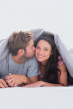 Man kissing his wife Royalty Free Stock Images