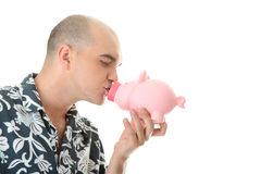 Man kissing piggy bank Royalty Free Stock Image