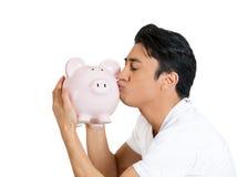 Man kissing piggy bank Royalty Free Stock Image