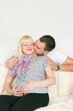 Man kissing pregnant wife Royalty Free Stock Photography