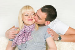 Man kissing pregnant wife Royalty Free Stock Image