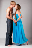 Man is kissing pregnant woman Royalty Free Stock Photography