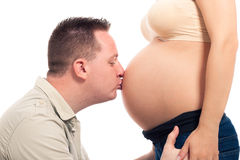 Man kissing pregnant woman belly Stock Photography