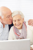 Man kissing senior woman at Stock Photography