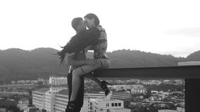 Man kissing with sensual black angel woman on the rooftop stock video footage