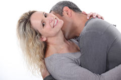 Man kissing wife's neck Stock Images