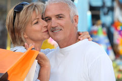 Man kissing woman Stock Images