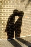 Man kissing a woman. An image of a shadow of a man kissing a woman Royalty Free Stock Photo