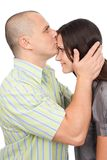 Man kissing woman on forehead Royalty Free Stock Image