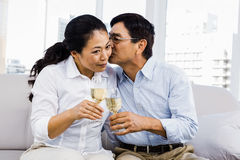 Man kissing woman with glasses of wine Royalty Free Stock Photos