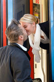 Man kissing woman goodbye train leaving romance Stock Photo