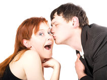 Man kissing woman. Guy kissing women in her cheek, isolated on white background Stock Images