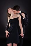 Man kissing woman on neck while removing dress strap Royalty Free Stock Photography