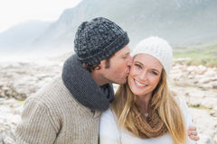 Man kissing a woman on rocky landscape Royalty Free Stock Photography