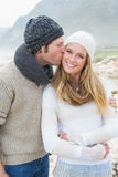Man kissing a woman on rocky landscape Stock Images