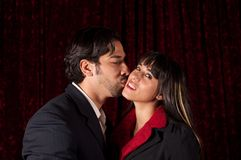 Man kissing woman's cheek Stock Photo