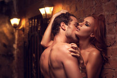 Man kissing woman's neck Royalty Free Stock Photography