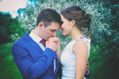Man Kissing Woman's Right Hand Stock Photo