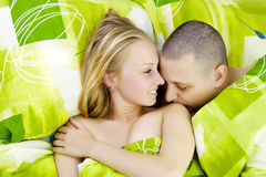 Man kissing woman`s shoulder. Royalty Free Stock Photos