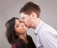 Man kissing a young woman Stock Image