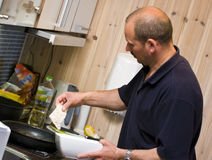 Man in kitchen Stock Photo