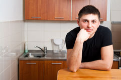 Man in kitchen Stock Image