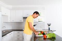 Man in kitchen Stock Image