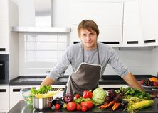 Man in kitchen Stock Images