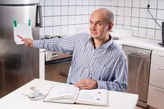 Man in the kitchen Stock Images