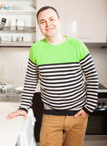 Man in kitchen. Adult happy man at domestic kitchen stock photos