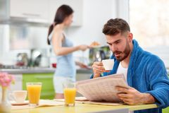 Man in kitchen in the morning stock photo