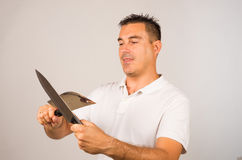 Man with kitchen knives Stock Photos