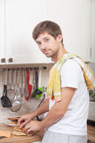 Man at the kitchen. Making bread with garlic stock images