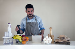 Man in the kitchen Royalty Free Stock Image