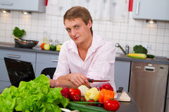 Man in the kitchen preparing salad Stock Photo