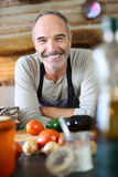 Man in kitchen ready to cook Royalty Free Stock Images