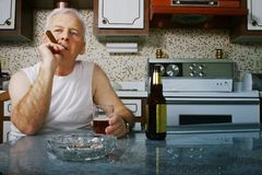 Man In Kitchen Relaxing Stock Photos