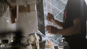 Man In The Kitchen Steering Fresh Made Cup Of Coffee stock footage