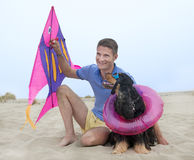 Man, kite and dog Stock Image