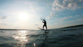 A man kite surfing on river. Kite surfer kiteboarding.