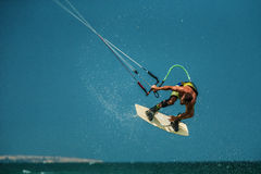Man Kitesurfing in blue sea Royalty Free Stock Images