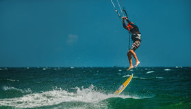 Man Kitesurfing in blue sea Stock Photography