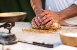 Man knead the dough Stock Image