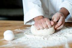 Man kneading dough, closeup shot Royalty Free Stock Photo