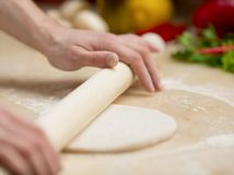 Man kneading dough for pizza Stock Photo